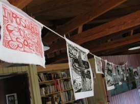 Prints drying on the line.